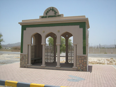 A Nizwa Municipality bus stop on the outskirts of town.