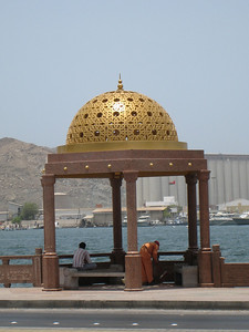 A gold domed gazebo on the corniche in Muscat.