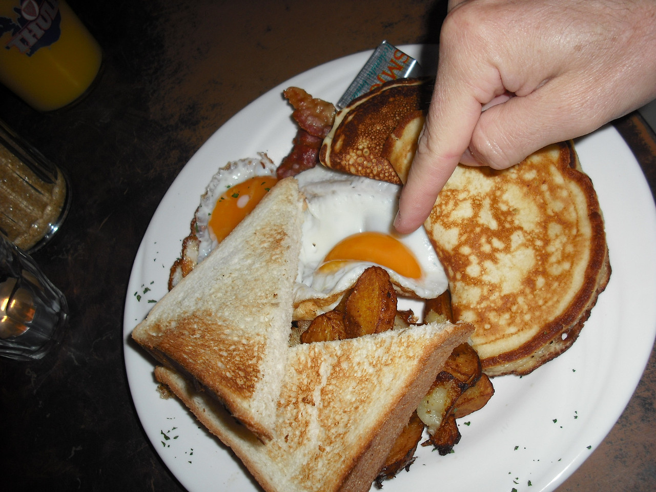 """It's day two.  Jenni's Icelandic experience was punctuated with a fried egg.  If you can believe this, it was her first fried egg.  When I told her you don't have to go to Iceland to get fried eggs, she said, """"Oh."""""""