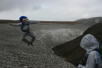Shane jumps for joy on the snowfield.