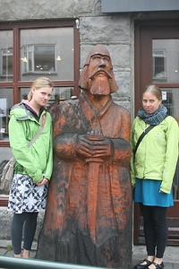 Aunika and Kjirsten scowl with the wooden guy.