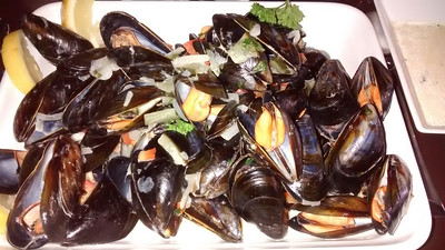 Vitinn Restaurant - Mussels steamed in a wine herb sauce - to die for.