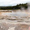 Strokkur geyser.  The center of the pool boils more violently, the water making a raised circle in the pool.