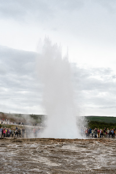 Strokkur geyser, very close to Geysir, for which all geysers are named.  Strokkur means churn in Icelandic.  Geyser means to gush.   Haukadalur Valley, Hafnartun, Selfoss, Iceland.  Near Hvita river.  First records of its eruption date to  1789.  Records of geyser activity in the area date to 1294.
