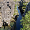 The water-filled continental rift, Flosagia, at Pingvellir National Park.  The North American and Eurasian tectonic plates divide here at the rate of 1mm to 18mm per year.
