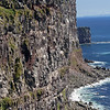 Latrabjarg Cliffs - well-worth the 42 km. rough drive to reach.  Note the people at the tops of the edges.<br /> June 19, 2017
