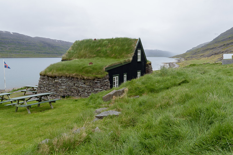 Litlibaer home with turf roof, (built 1895),  now converted to  coffeehouse overlooking Skotufjordur. <br /> June 18, 2017