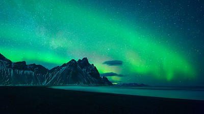 Lights appear over Vestrahorn near Hofn