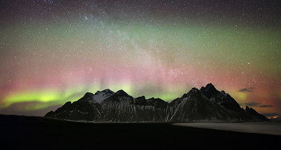Northern Lights spread through the sky atop Vestrahorn mountain