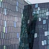 """Mosaic"" of glass covering The Harpa Center."