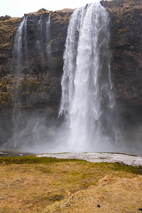 Seljalandsfoss waterfall drops 197 ' into the pool below.