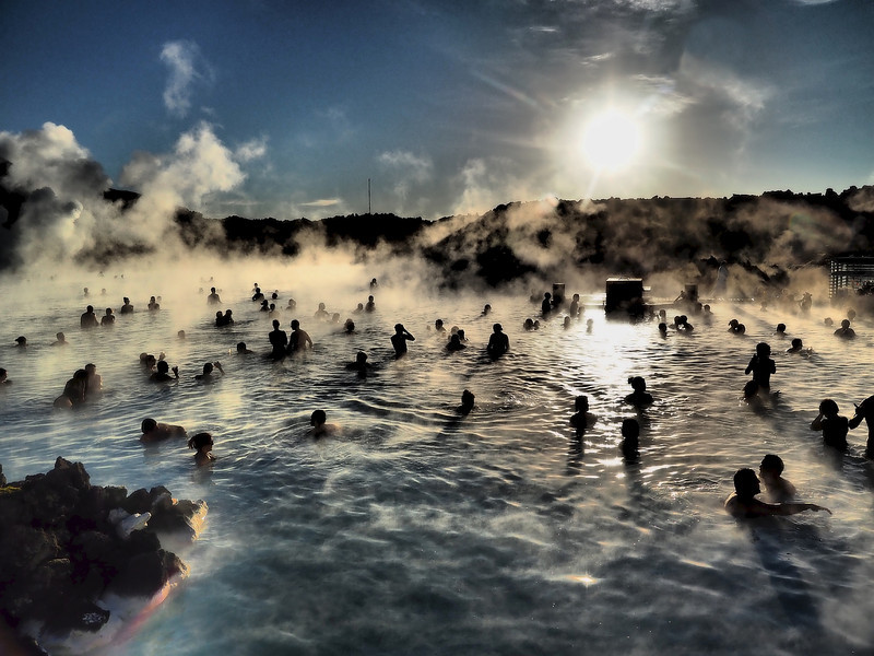 Blue Lagoon Geothermal pools. Olympus E-M1, 12-60mm SWD 4/3 lens. Hot (mid 80'sF) and milky blue water rich in minerals like silica and sulphur constantly oozing steam are not the usual places one would take a camera..... perfect, in with the the E-M1 I went. The milkly blue water, steam and reflecting sunlight made for a harsh and dramatic environment in which to test out the various art filters and high dynamic range environment. I really liked the dramatic tone images such as this, shooting into the sun and effecting eerie shadow like creatures.