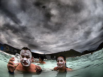 The famous Blue Lagoon in South west Iceland. A Geothermal wonder with water naturally heated to 100F. The seawater originates 2000 meter/6562 ft beneath the ground where it is heated by earth's natural forces. At this depth the temperature is 240°C/464°F and the pressure is 36 times the pressure on the earth's surface. The geothermal seawater comes into contact with cooling magmatic intrusions and captures the earth's minerals, resulting in this unique natural source known for its healing power and actives. The composition of minerals in the water is very distinctive and has a high level of silica. Its environment is characterized by high temperature and salinity level of 2.5% which is 1/3 of the ocean's salinity level. Good for skin, not for camera. Tested the camera in movie mode underwater and it came up fine, still working. A testament to the Olympus watertight build quality. This weird effect is the result of the new 'Dramatic Tone' art filter. Gives a wild look to boring skies :-)