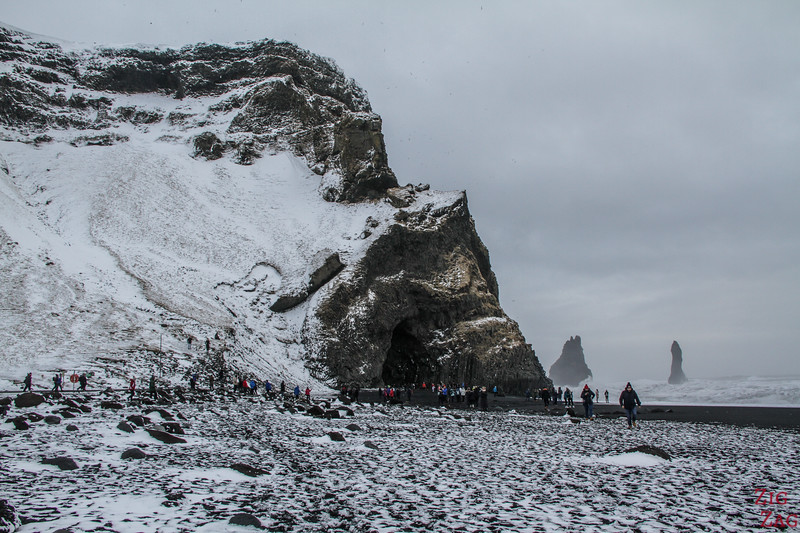 Reynisfjara black sand beach with snow in Winter