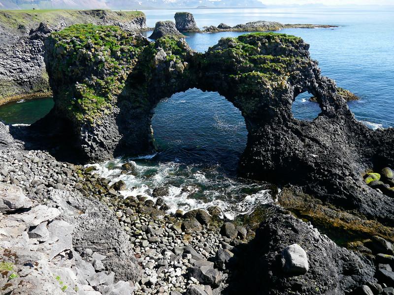 Iceland, June 2014, Overseas Adventure Travel (OAT) trip.<br /> Village of Arnarstapi.  Gatklettur - Arch Rock.