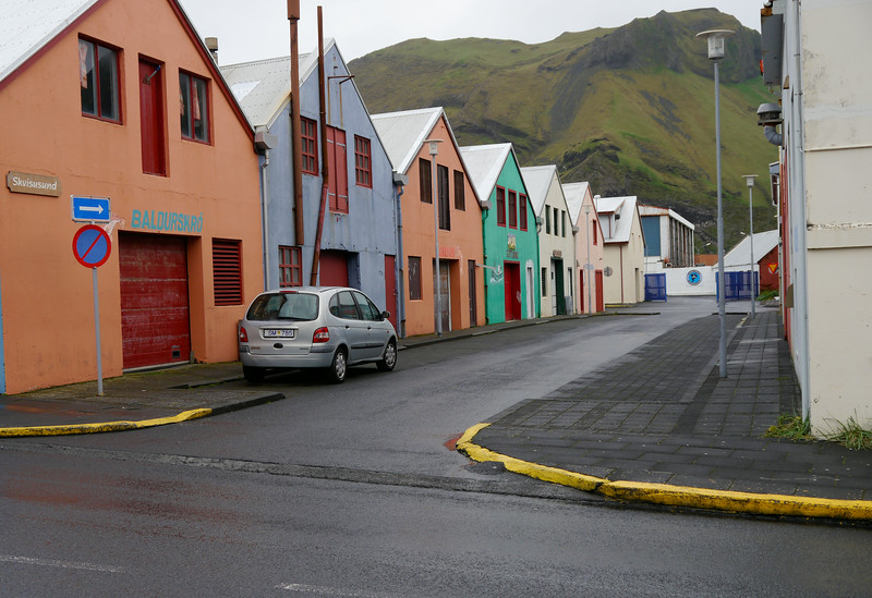 Iceland (Westman Island), June 2014, Overseas Adventure Travel (OAT) trip.<br /> A street close to the harbor.  At one time they may have been merchants buildings or warehouses.
