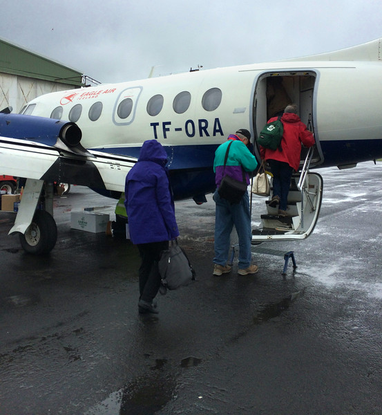 This image was taken by Mel Yokoyama and graciously provided to me.  <br /> Me, in the green jacket, getting on the plane for the short hop from Reykjavik to Westman Island.  Iceland, OAT, June 2014.