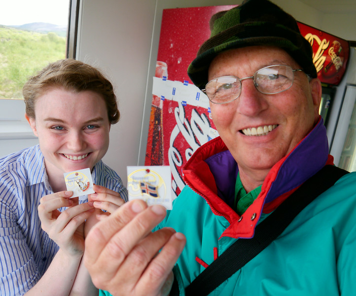 Iceland, June 2014, Overseas Adventure Travel (OAT) trip.<br /> There is a little snack bar and souviner shop at the Hraunfossar and Barnafoss waterfalls.  I bought a couple of lapel pins and had my picture taken with the salesgirl.
