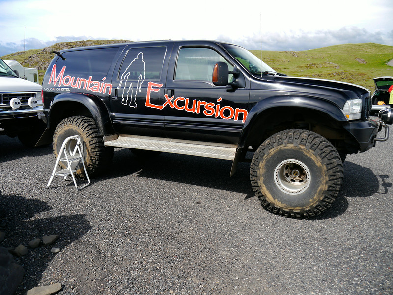 Iceland, June 2014, Overseas Adventure Travel (OAT) trip.  <br /> The 4-wheel drive vehicles take us around a small peninsula, or promontory, called Dyrholaey, near the village of Vik.  We go both high and low.  Black beaches, caves, and Basalt columns.