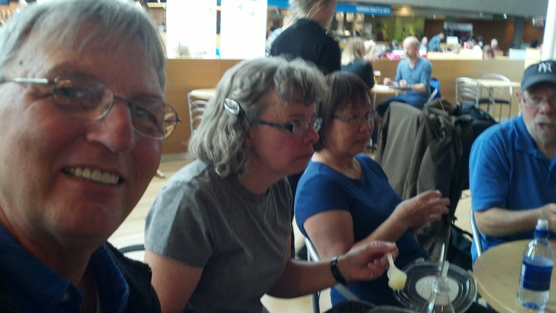 Iceland, June 2014, Overseas Adventure Travel (OAT) trip.  <br /> Some of us have a snack and rest a bit at Reykjavik Airport before catching our flights home.  Me, Kathleen, Anna, and Arnie.