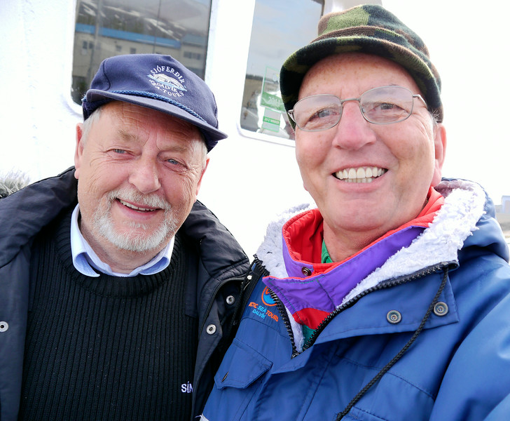 """Iceland, June 2014, Overseas Adventure Travel (OAT) trip.<br /> Departing from the fishing village of Dalvik we head out on a restored wooden fishing boat, the """"Draumur"""", for whale watching and fishing.  Only saw one whale but caught a lot of fish.<br /> Me with the Captain."""