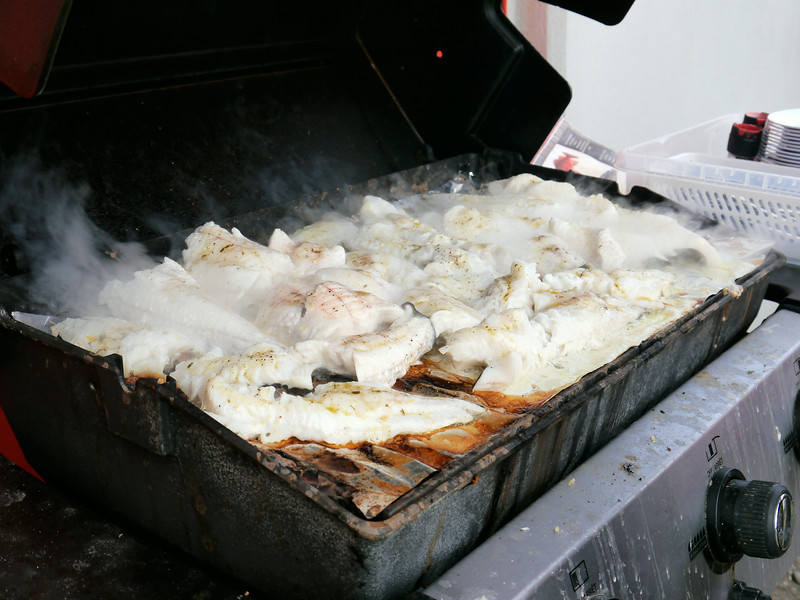 """Iceland, June 2014, Overseas Adventure Travel (OAT) trip.<br /> After our boat trip on the """"Draumur"""" we return to Dalvik and the crew cooks our freshly caught fish on the grill.  Fantastic!"""