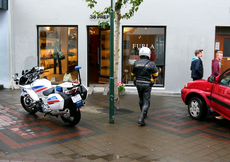 Iceland, June 2014, Overseas Adventure Travel (OAT) trip.<br /> A Policeman and his motorcycle in downtown Reykjavik.