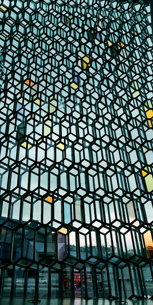 "Iceland, June 2014, Overseas Adventure Travel (OAT) trip.  <br /> ""Harpa"" is an asymmetrical glass building on Reykjavík's harbor that resembles a shimmering iceberg that crashed onto the shore. It is an opera and concert hall that opened in 2010."