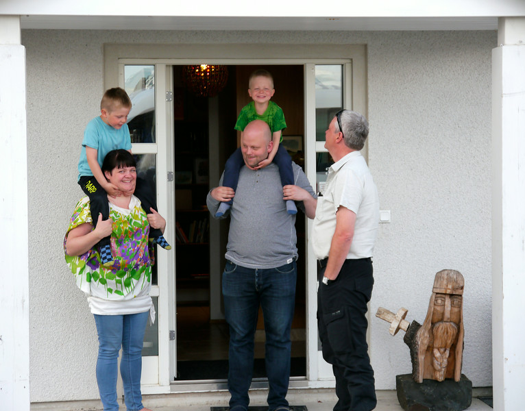 "Iceland, June 2014, Overseas Adventure Travel (OAT) trip.<br /> ""Home-hosted"" dinner for my half of the group.  Akureyri.  Beggi, our OAT Guide, chats with the family before we depart."