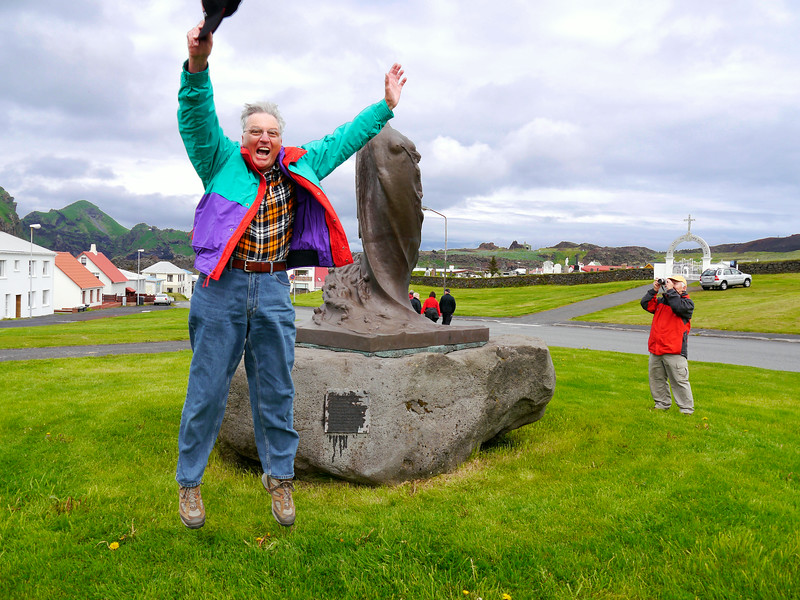 """Iceland (Westman Island), June 2014, Overseas Adventure Travel (OAT) trip.<br /> Me, jumping in front of the statue, """"Alda Aldanna"""" (The Wave of the Ages) by Einar Jonsson."""