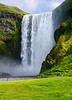 Iceland, June 2014, Overseas Adventure Travel (OAT) trip.  <br /> Seljalandsfoss Waterfall.  The water drops 200 feet and you can walk behind the waterfall.  It was a waypoint during the first leg of The Amazing Race 6.