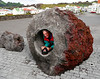 Iceland (Westman Island), June 2014, Overseas Adventure Travel (OAT) trip.<br /> This was just above the Park and in front of the Library/Museum.  It's a peice of lava with a very smooth hole in it.  Don't know anything else about it but I had to climb through it, for sure!