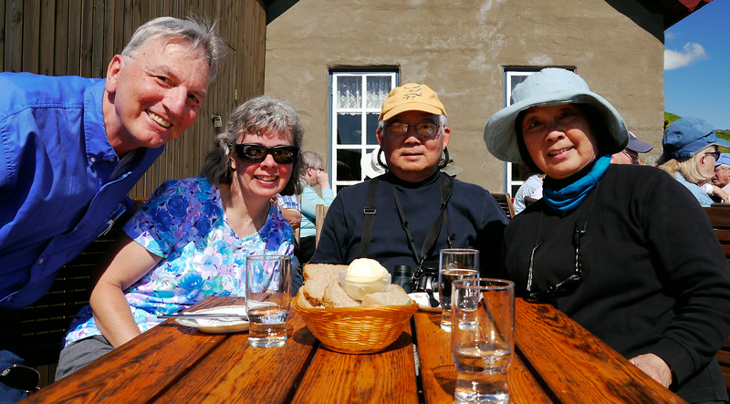 Iceland, June 2014, Overseas Adventure Travel (OAT) trip.<br /> Village of Arnarstapi.  We have lunch outdoors at a quaint cafe with a beautiful view of the coastline.  Ed (me), Kathleen Bell, and Mel & Anna Yokoyama.
