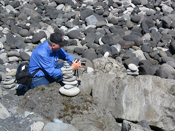 This image was taken by Kathleen Bell and graciously provided to me.  <br /> Just me taking a picture of my stone pile- 3 stones- stands for O-A-T.  <br /> Iceland, OAT, June 2014.