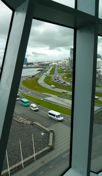 """Iceland, June 2014, Overseas Adventure Travel (OAT) trip.  <br /> """"Harpa"""" is an asymmetrical glass building on Reykjavík's harbor that resembles a shimmering iceberg that crashed onto the shore. It is an opera and concert hall that opened in 2010."""