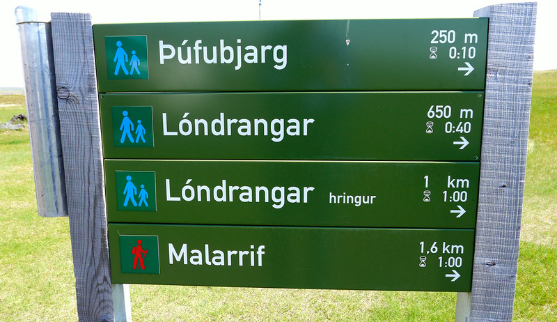 Iceland, June 2014, Overseas Adventure Travel (OAT) trip.<br /> Arnarstapi.  I believe this is a sign showing the hiking distances, times, and difficulty to various rock formations.