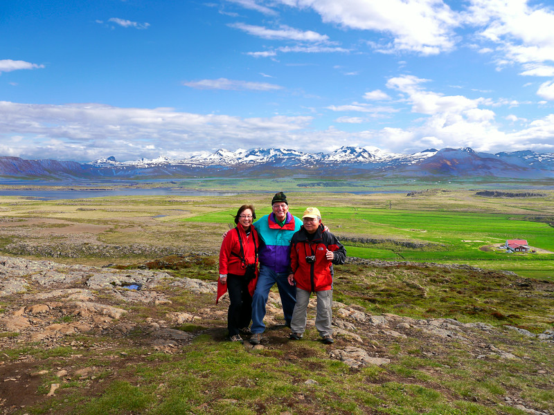 """Iceland, June 2014, Overseas Adventure Travel (OAT) trip.<br /> Helgafell (""""holy mountain"""") is a small mountain on the Snæfellsnes Peninsula of Iceland. The mountain is 73 metres (240 ft) high, and a temple in honor of Þór was built there by the first settler of the area, Þórólfr Mostrarskegg. We climbed to the top!<br /> (In this picture: Anna & Mel Yokoyama and me in the middle.)"""