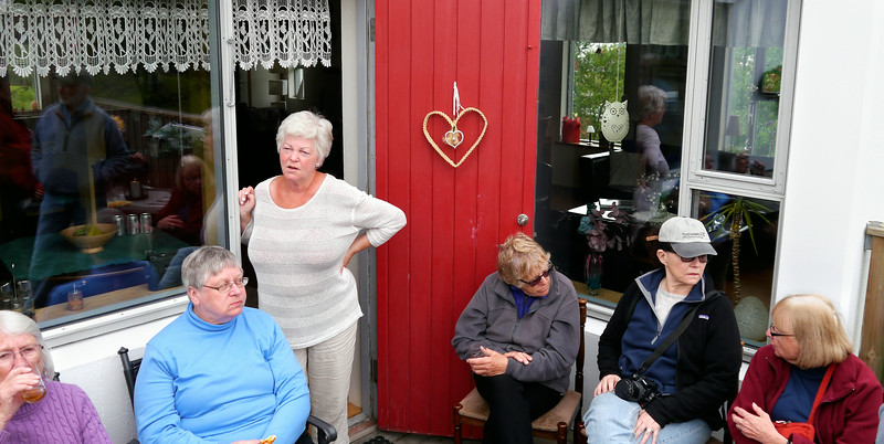 Iceland, June 2014, Overseas Adventure Travel (OAT) trip.<br /> Back in Akureyri, Elle, our driver, has us over to his house for some snacks and drinks.  Elle is in the Blue shirt and his wife is the lady with the tan knit top.