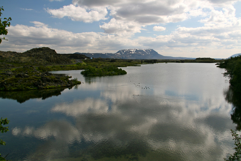 Around Lake Myvatn. I rented a bike and rode around the lake 22 miles, stopping to do hikes along the way. You can see the road on the right.