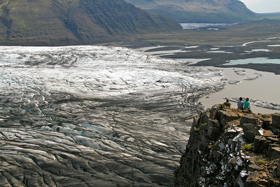 Hikers in Skafatel National Park, South Iceland, above the glacier.