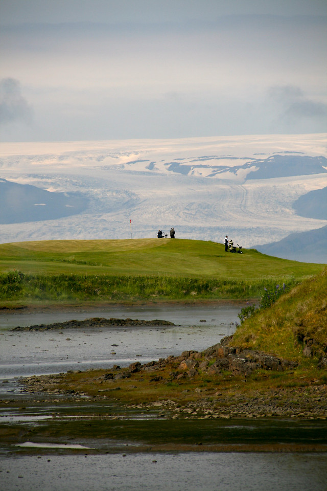 Golf course with huge glacier behind. Town of Hofn, South Iceland.