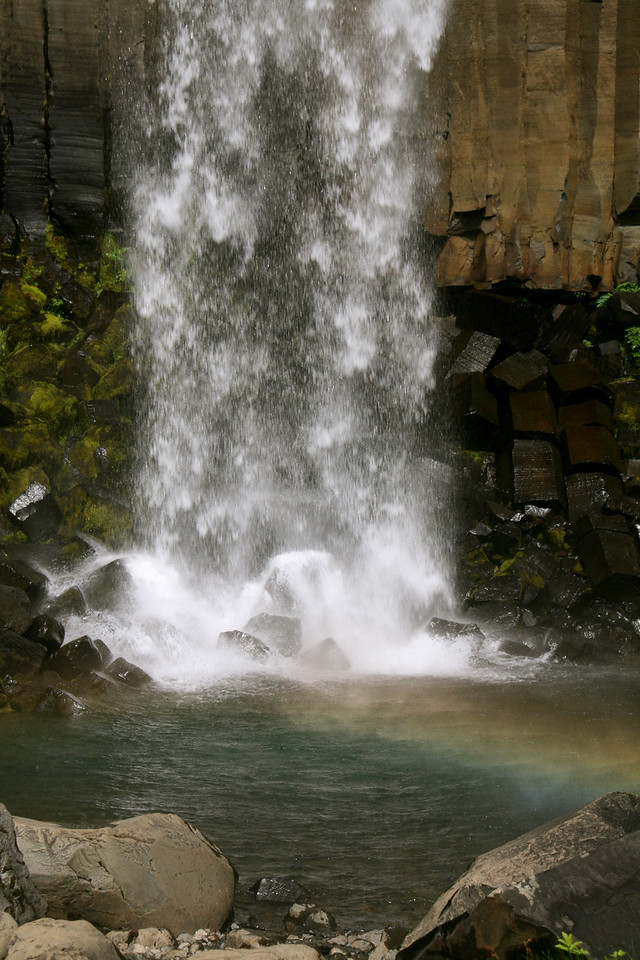 Rainbow and waterfall.