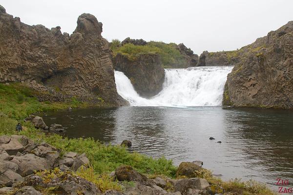 Hjalparfoss waterfall and its pool