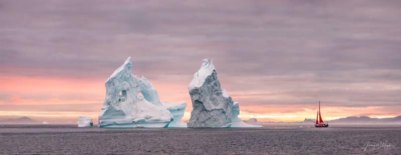 This amazing single iceberg had two huge intricate and unstable pillars. If one collapses as it surely will in a few days the whole berg will roll. Sailing close to it is not for the inexperienced. 5 shot handheld pano stitched in Photoshop