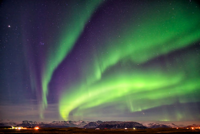 Aurora near Höfn, Iceland. The Pleiades are visible in the upper left, and comet PanSTARRS is in the lower right, just above the glacier.