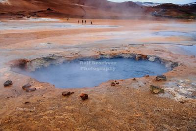 Boiling mud pools at Hverir Geothermal Area in Northeast Iceland