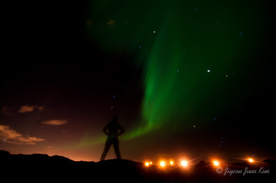 Standing in front of Aurora Borealis aka Northern lights