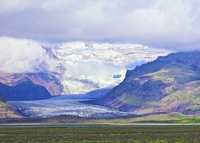 Iceland:  Black Sand Beaches, Icebergs rolling in the Atlantic surf, vast glacial plains that run down to the sea.