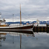 Husavik Harbour and one of the many Tourist Whale boats.