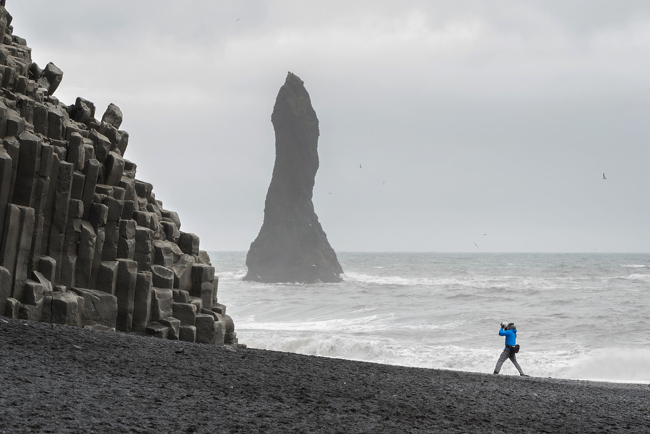 Chris braves the elements to get his shot.  Black Sand Beach, Vik.